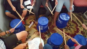 Playing bucket drums is Heartbeat. Let the children drum. Let the children come!
